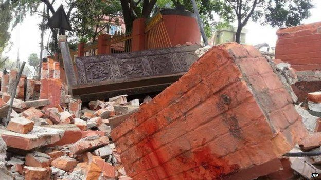 In this photo released by China's Xinhua News Agency, a collapsed building is seen in Nepal's capital Kathmandu Saturday, April 25, 2015