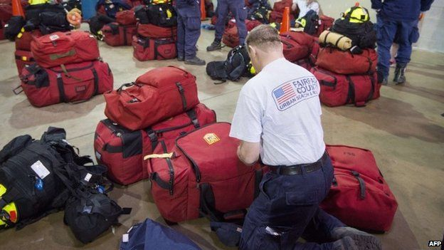American search and rescue team member prepares from deployment to Nepal (25 April 2015)