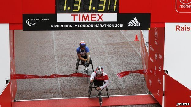 "USA""s Joshua George wins the Men""s wheelchair race ahead of Great Britain""s David Weir"