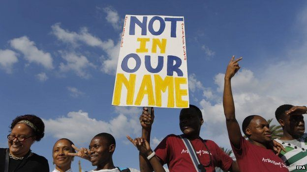Some of the thousands of people are seen carrying anti xenophobia posters during a mass march calling for an end to attacks against foreign nationals, Johannesburg, South Africa, 23 April 2015.