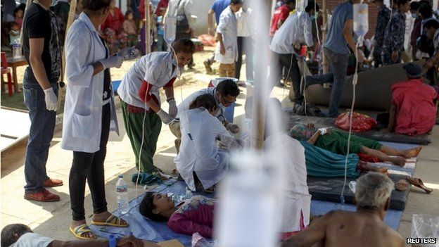 Earthquake victims receive medical treatment outside the overcrowded Dhading hospital, in the aftermath of Saturday's earthquake, in Dhading Besi, Nepal April 27, 2015