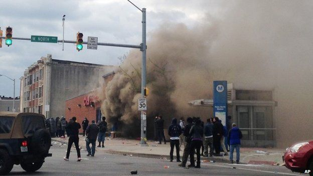 Smoke billows from a CVS Pharmacy store in Baltimore