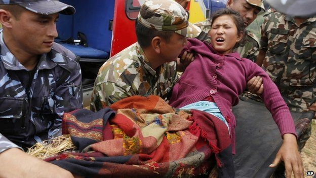 Injured woman arrives by helicopter from Ranachour village at town of Gorkha, Nepal. 28 April 2015