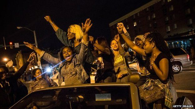 Protesters party in the streets after criminal charges were announced against six police officers