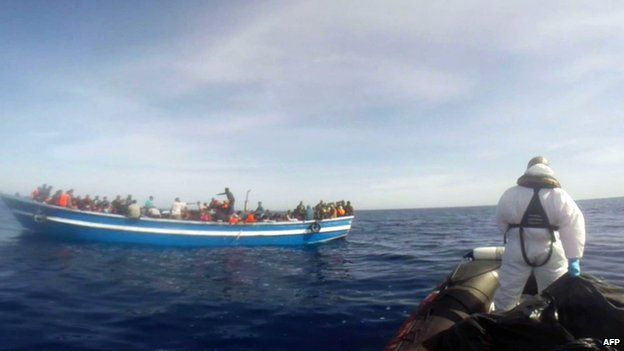 Video grab showing an Italian coastguard taking part in a rescue operation of a boat carrying 397 migrants on 2 May 2015, in the Mediterranean Sea (released by the Italian coastguard)