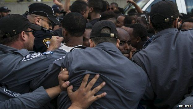 Israeli policemen push protesters, mainly whom are Israeli Jews of Ethiopian origin- Tel Aviv May 3, 2015.