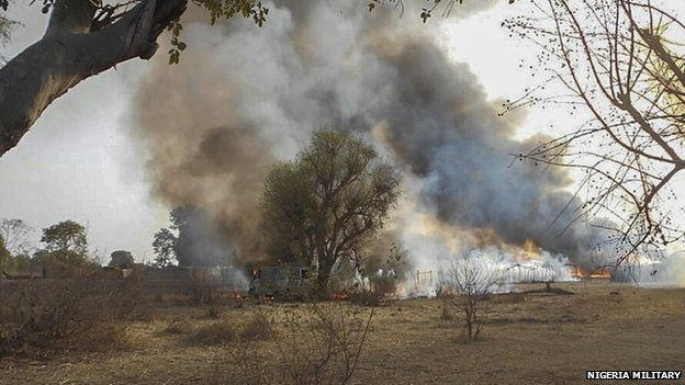 A handout picture dated 3 May 2015 released by the Nigerian army shows a Boko Haram camp being destroyed in the Sambisa forest, Borno state, Nigeria
