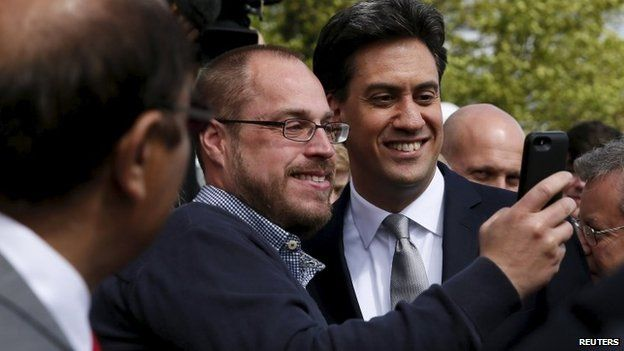 A man takes a selfie with Ed Miliband during the Labour leader's visit to Brighton