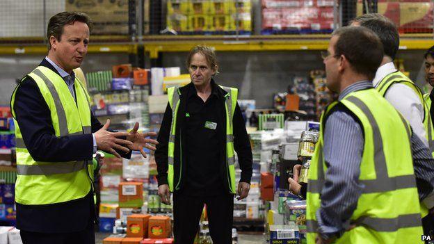 David Cameron talking to shift workers at an Asda depot in Bristol