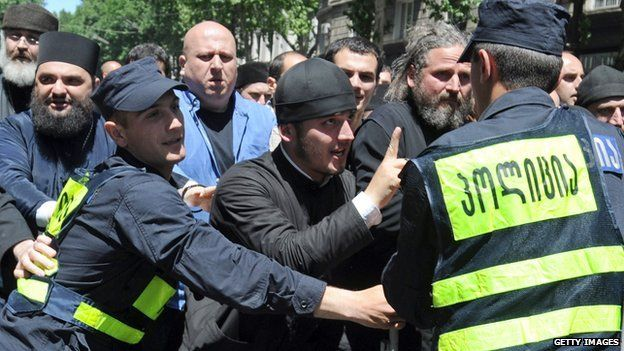 Orthodox priests protest over the gay rights march in Tbilisi on May 17, 2013