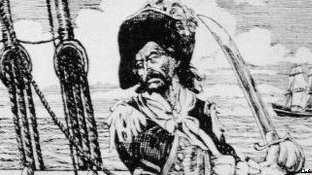 Drawing of Scottish-born American privateer and pirate William 'Captain' Kidd standing on the deck of a ship, brandishing a sword, circa 1690