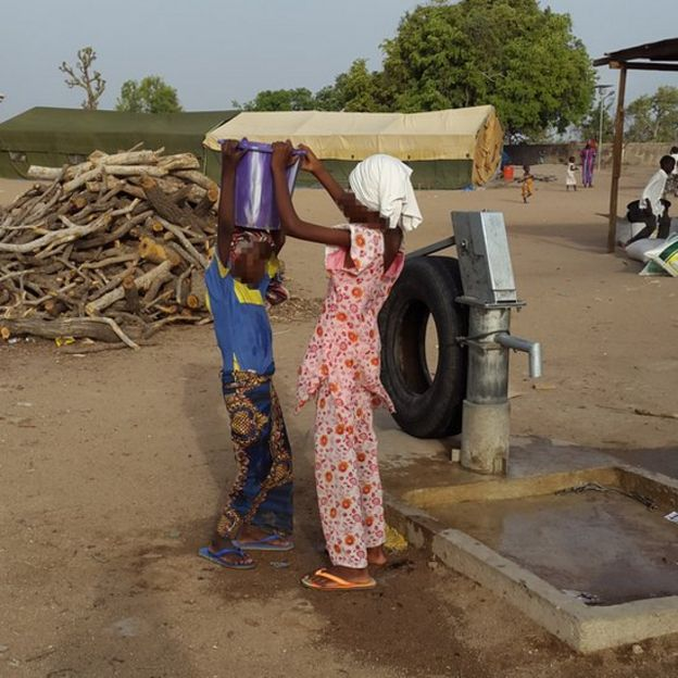 Two girls at water pump in Yola (May 2015)