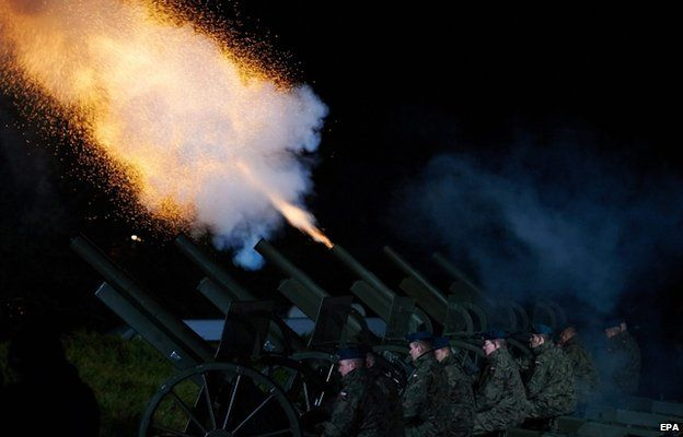 Polish military officers fire artillery during the commemoration ceremonies marking the 70th anniversary of the end of World War Two in Europe in Gdansk-Westerplatte 7 May 2015