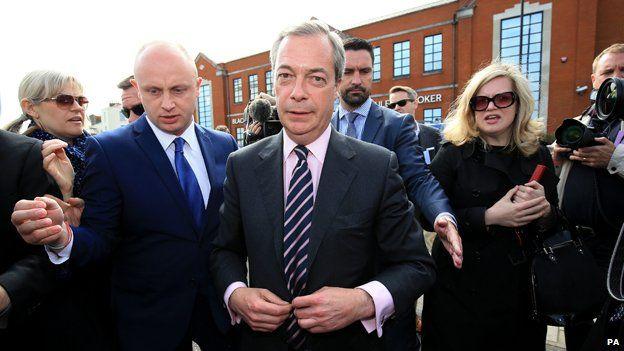 Nigel Farage followed by reporters