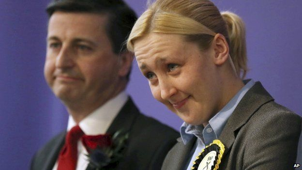 Paisley and Renfrewshire South constituency winner Mhairi Black of the Scottish National Party (SNP) and Labour's Douglas Alexander react at the Lagoon Leisure Centre in Paisley, Scotland Friday May 8, 2015.