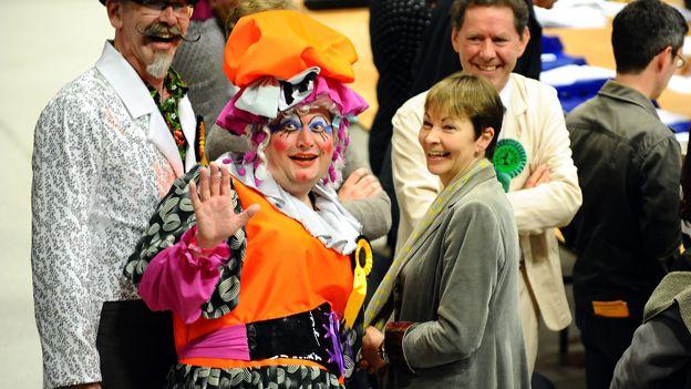 Caroline Lucas with a pantomime dame