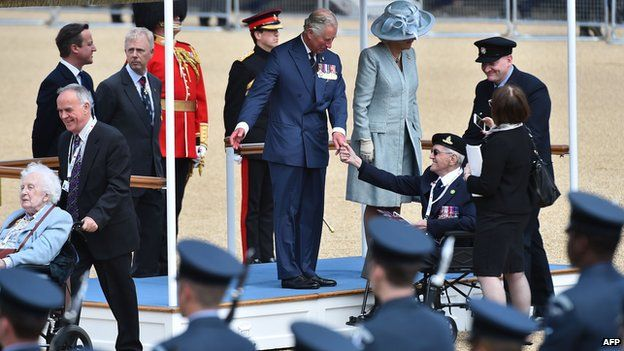 Prince Charles and the Duchess of Cornwall greet veterans