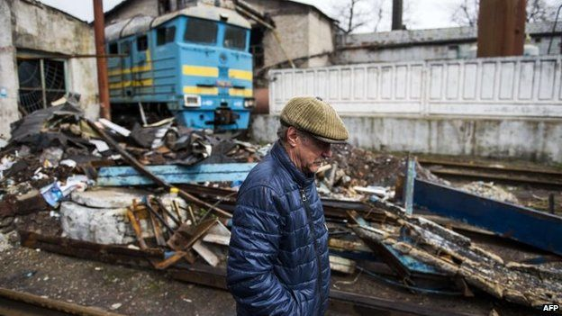 A man walks near a damaged train station in Debaltseve, eastern Ukraine. Photo: April 2015