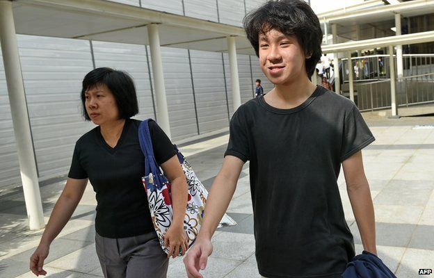 Amos Yee (R), a 16-year-old student, and his mother leave the State courts in Singapore on 31 March 2015.