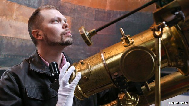 Astrophysicist Duane Hamacher with a telescope