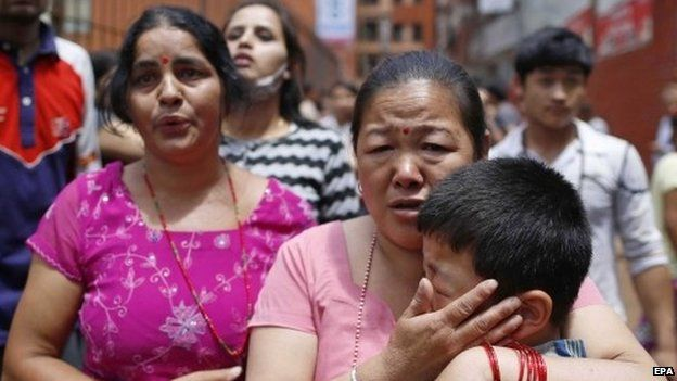 Nepalese run for open space as a strong earthquake hits Kathmandu, Nepal, 12 May 2015.