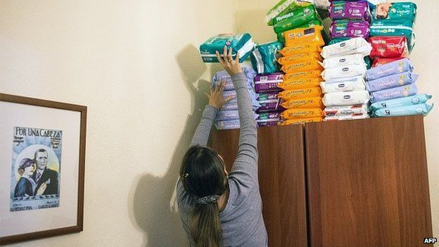 A woman stacks nappies