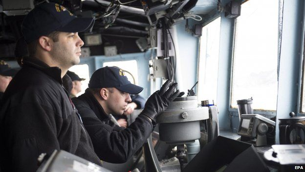 US Navy sailors monitor the area aboard US Navy's USS Vicksburg participating in NATO's Dynamic Mongoose anti-submarine exercise in the North Sea off the coast of Norway