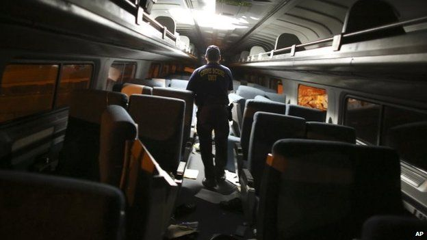 A crime scene investigator checks inside one of the carriages. Photo: 12 May 2015