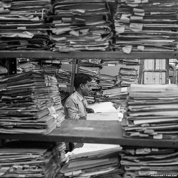An official amid stacks of files at Patna High Court