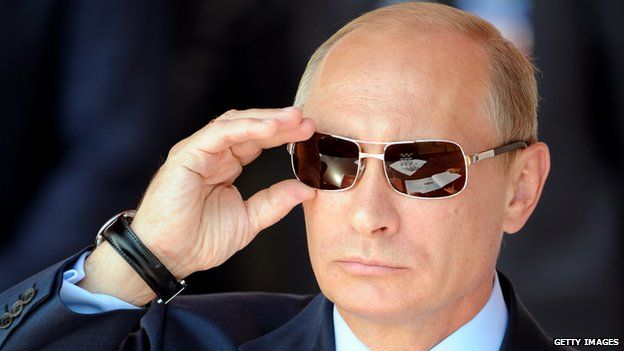 Vladimir Putin watches an air show in 2011