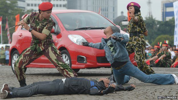 A female member of the Indonesian Special Army Forces and Marines show their martial arts skills in Jakarta on April 22, 2013