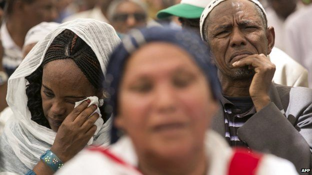 An Israeli of Ethiopian descent cries during a ceremony in Jerusalem commemorating Ethiopians that died during their immigration to Israel