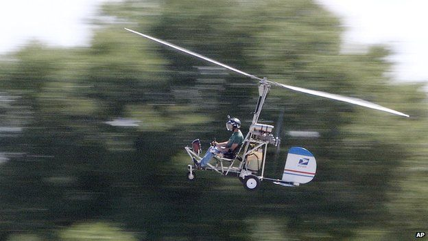 In this March, 2015, photo, Doug Hughes flies his gyrocopter near the Wauchula Municipal Airport in Wauchula, Flordia