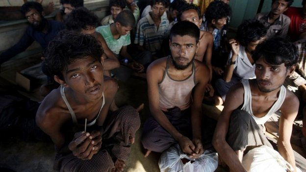 Rescued migrants rest upon arrival in Simpang Tiga, Aceh province, Indonesia Wednesday, May 20, 2015.