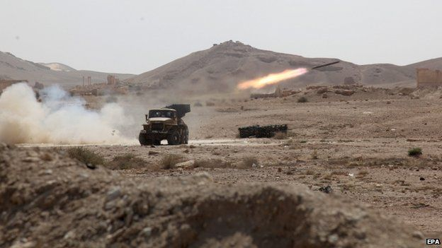 Syrian rocket launcher shell on enemy positions in the ancient oasis city of Palmyra, 19 May