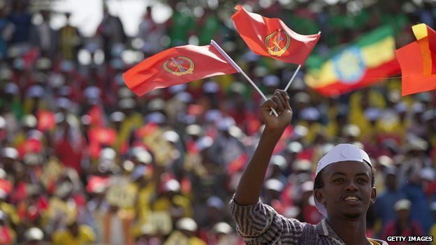 A youth waves the ruling party Ethiopian Peoples Revolutionary Democratic Front (EPRDF) flag in front of a large crowd during an election rally by the EPRDF