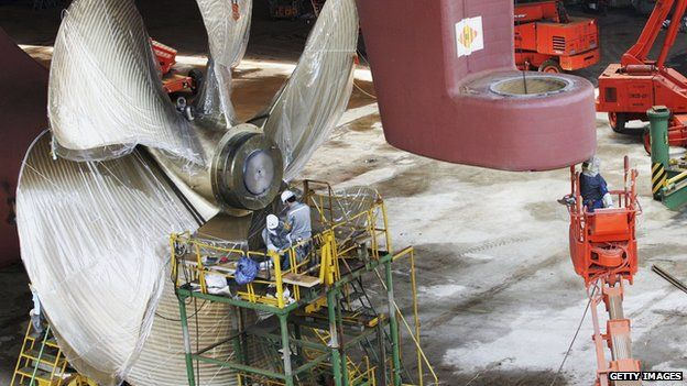A massive propeller being fitted