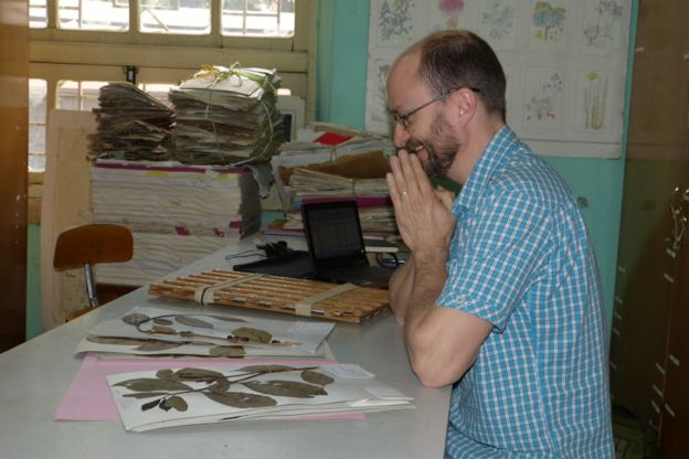 Dr Aaron Davis with some coffee samples at Kew