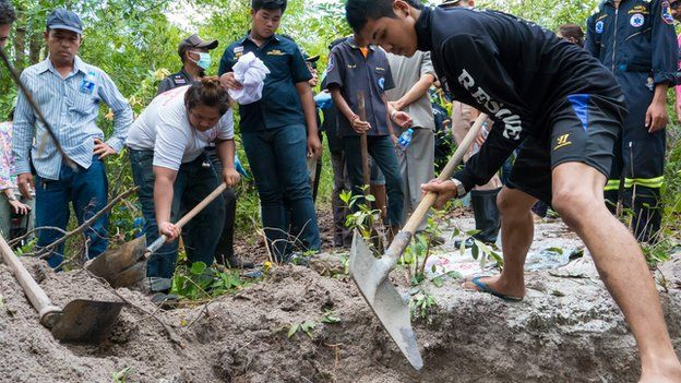 Thai volunteers exhume unmarked migrant graves in the forest