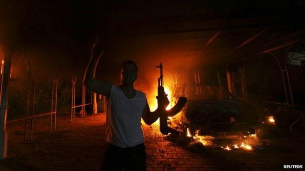A protester holding a gun