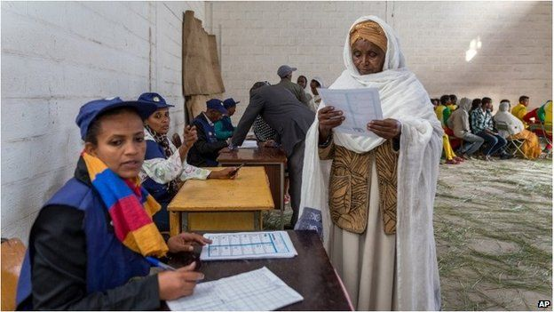 A woman looks at the election paper before voting in Addis Ababa.