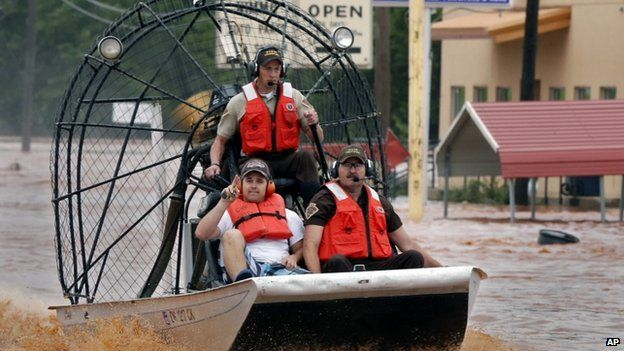 Highway patrolmen use air boats for rescues in Purcell, Oklahoma, 24 May