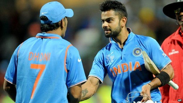 India's Virat Kohli, right, is congratulated by his captain MS Dhoni after they defeated Ireland by eight wickets in their Cricket World Cup Pool B match in Hamilton, New Zealand, Tuesday, March 10, 2015.