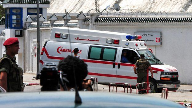 An ambulance is seen outside the Bouchoucha army barracks after a shootout incident, in Tunis 25 May