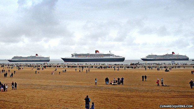 Queen Elizabeth, Queen Mary 2 off Crosby Beach ready to enter the River Mersey
