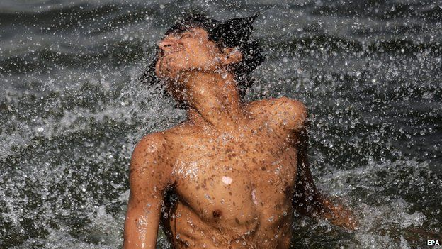 An Indian youth frolics in the Sabarmati river