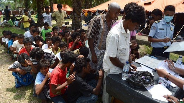 Rohingya men register for Indonesian immigration documentation at confinement area at Bayeun, Aceh province. 21 May 2015