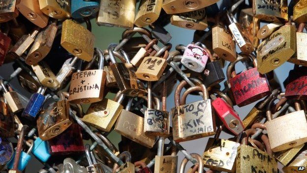 This April 9, 2014 file photo shows love locks fixed on the Pont des Arts bridge in Paris, France