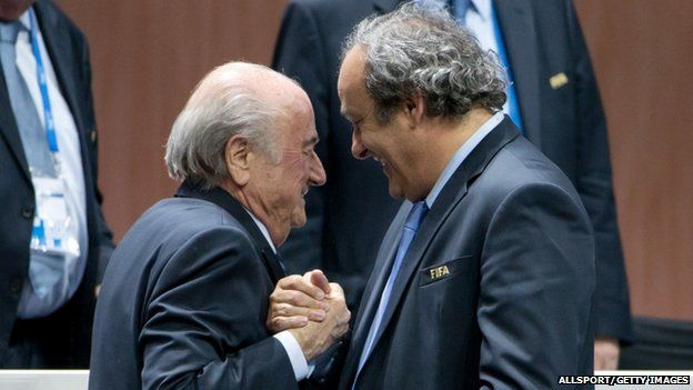FIFA President Joseph S. Blatter (L) shakes hands with UEFA president Michel Platini during the 65th FIFA Congress at Hallenstadion 29 May 2015