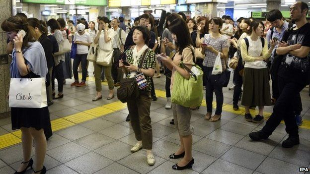 Commuters are stranded at Ikebukuro station as railway service is disrupted after a strong earthquake hit Tokyo area, Japan, 30 May 2015